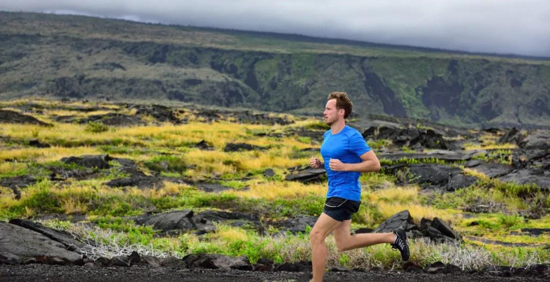male runner running on mountain road running man jogging fast training