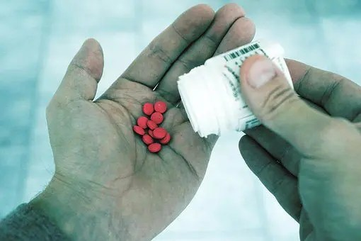 blog picture of open hand pouring some pills into it