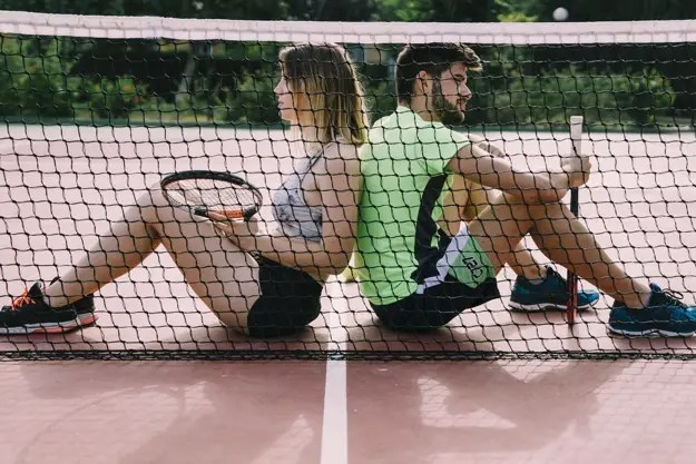 tennis elbow players taking break at the net