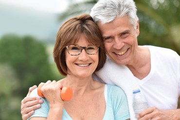 Portrait of senior couple in fitness outfit