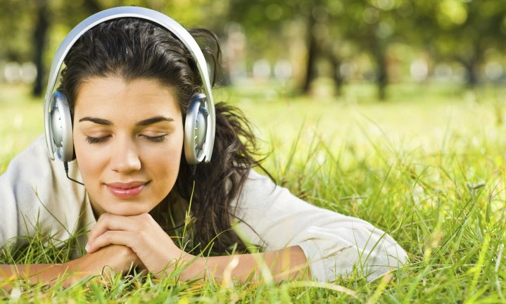 Young woman listening to favourite Meditation Audiobook on Audible