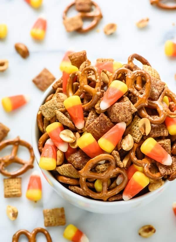 Sweet and Salty Halloween Chex Mix with Candy Corn and Maple Peanuts. ADDICTIVE! So cute for Halloween too!