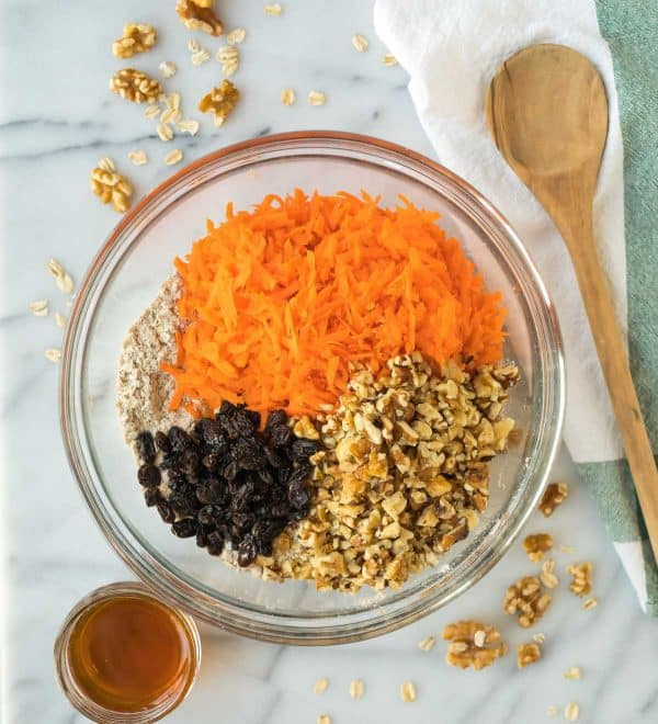 Batter to make healthy oatmeal carrot cookies with shredded carrots, raisins, oatmeal, and walnuts.