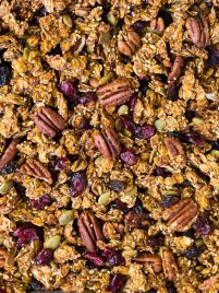BEST EVER Healthy Pumpkin Granola with oats, quinoa, and pecans! Sweet and crunchy with all the flavors of fall. Clean eating recipe made with simple ingredients. NO oil or refined sugar. Easy, gluten free, and perfect for healthy breakfasts and snacks. Recipe at wellplated.com