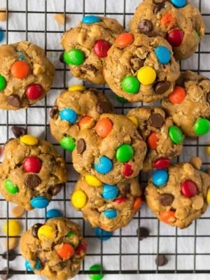 BEST Monster Cookies recipe. Thick, soft, and chewy peanut butter oatmeal cookies, stuffed with chocolate chips, M&M candies, and peanut butter chips. Our favorite cookie recipe!