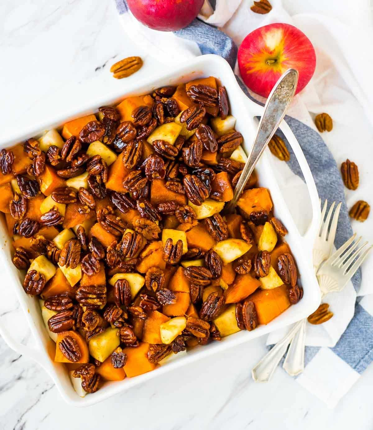 Glazed Sweet Potato Bake with Cinnamon Butter Pecans. The BEST sweet potatoes for Thanksgiving, Christmas, or anytime you need a great side dish recipe. Recipe at wellplated.com | @wellplated