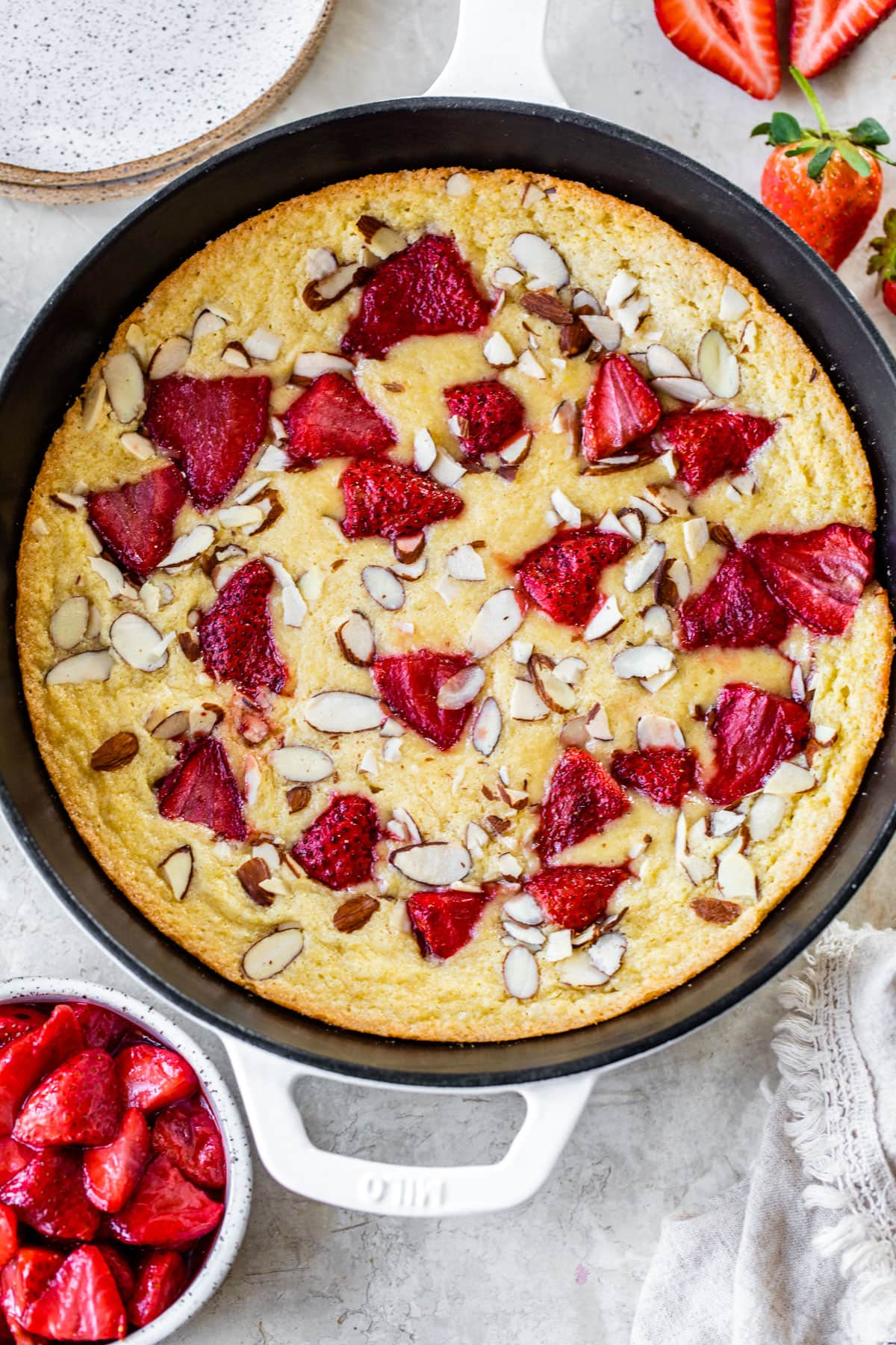 Strawberry Almond Skillet Cake. Moist and easy to make almond cake baked in a skillet and topped with roasted strawberries.