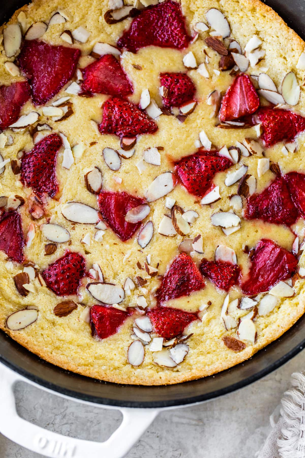 Strawberry Almond Skillet Cake. An ultra moist one-bowl almond cake topped with roasted strawberries.