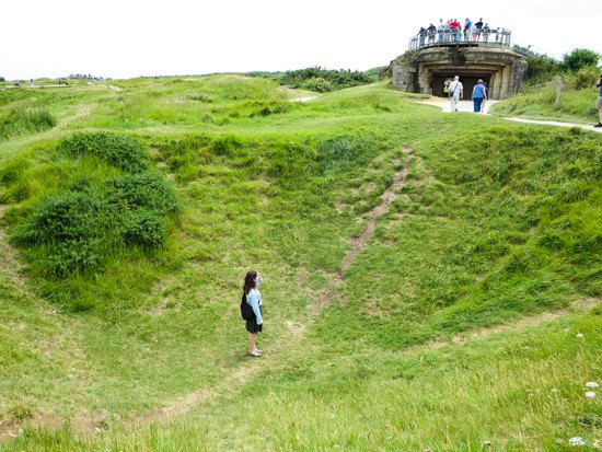 Elizabeth in the crater at Pointe du Hoc