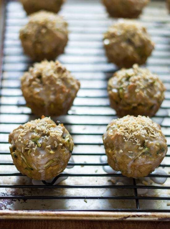 Zucchini Coconut Muffins - Healthy zucchini muffins made with coconut oil and whole wheat flour, with toasted coconut on top.