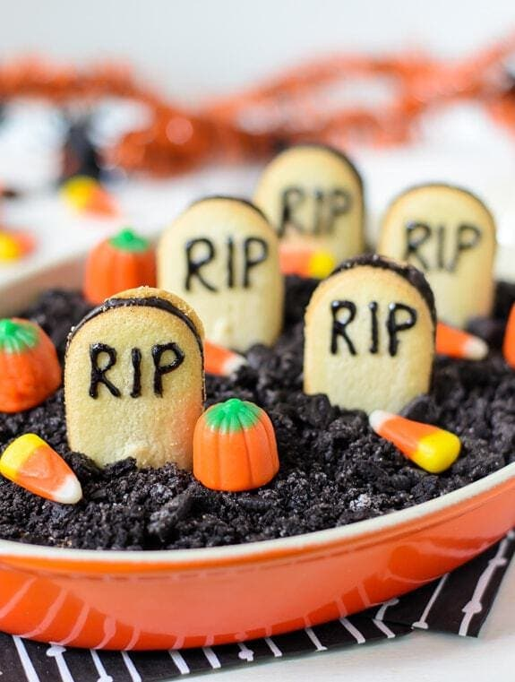 Graveyard Chocolate Cheesecake Dip - Tastes just like a chocolate cheesecake with Oreos on top!
