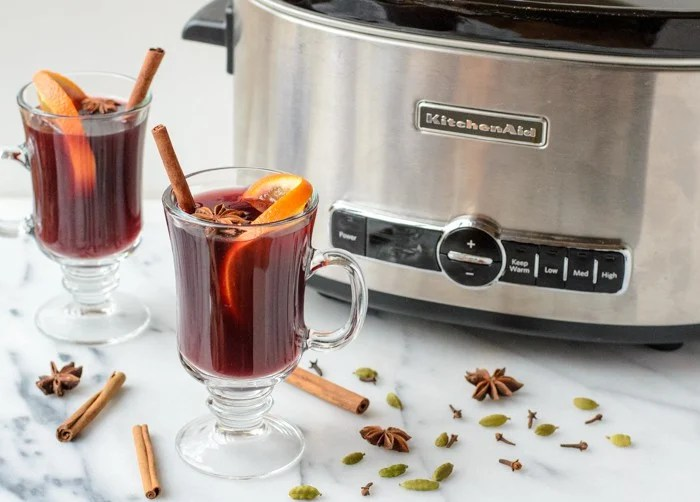 Healthy mulled wine recipe made in the slow cooker served in glasses with cinnamon sticks