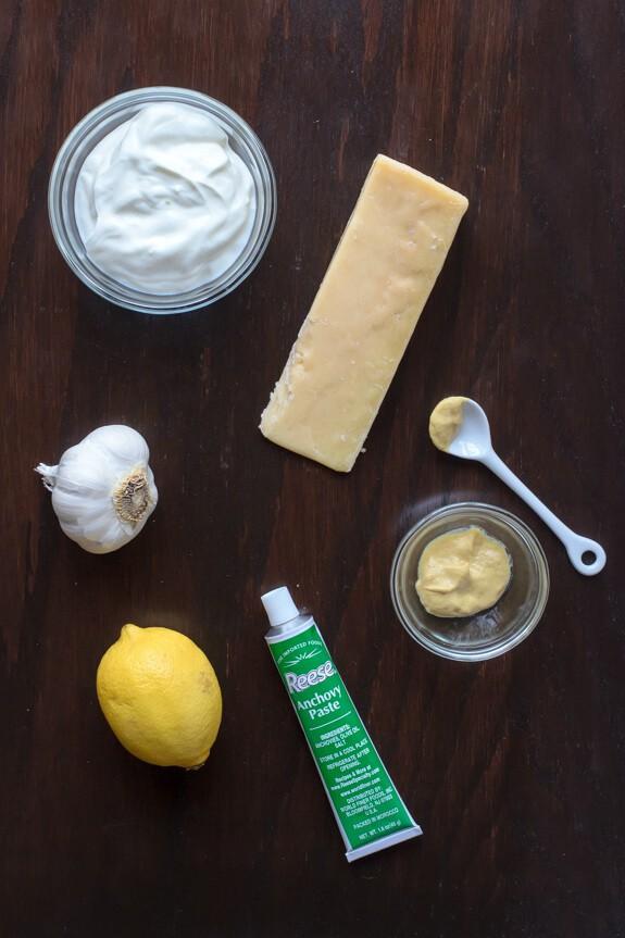 Garlic, lemon, Greek yogurt, Parmesan cheese, Dijon mustard, and anchovy paste for topping a salad