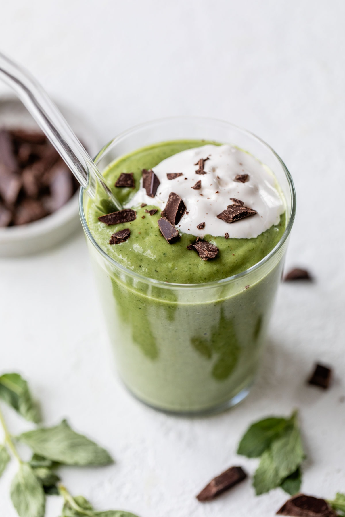 A healthy mint smoothie made with avocado and spinach that tastes just like the McDonald's Shamrock Shake