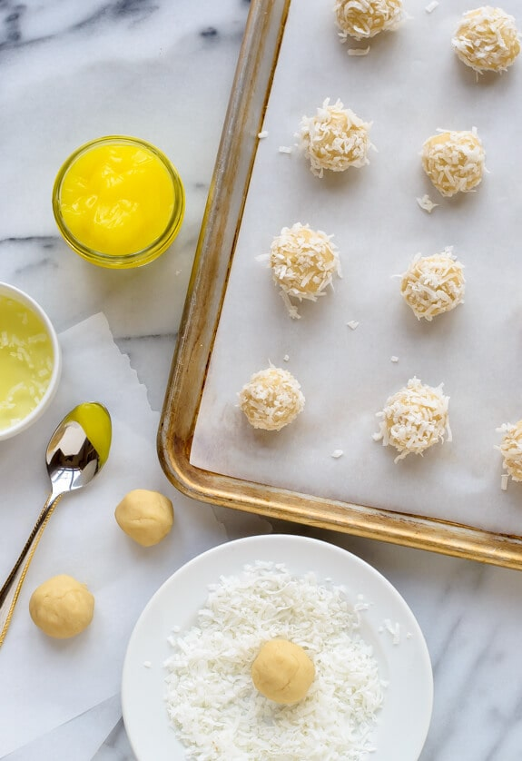 Buttery Lemon Thumbprint Cookies rolled in coconut