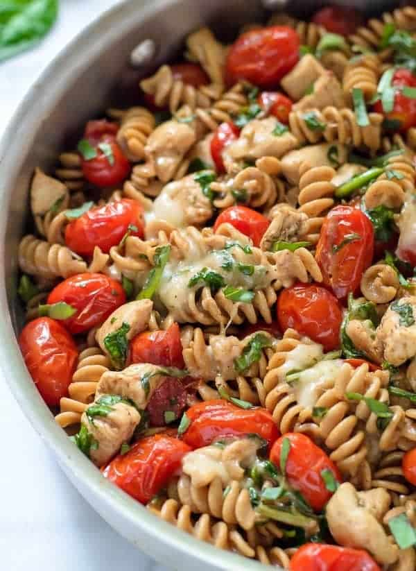 30 Minute Caprese Chicken Pasta. A chicken mozarella pasta inspired by the flavors of caprese salad. Our whole family loves this easy chicken pasta recipe!