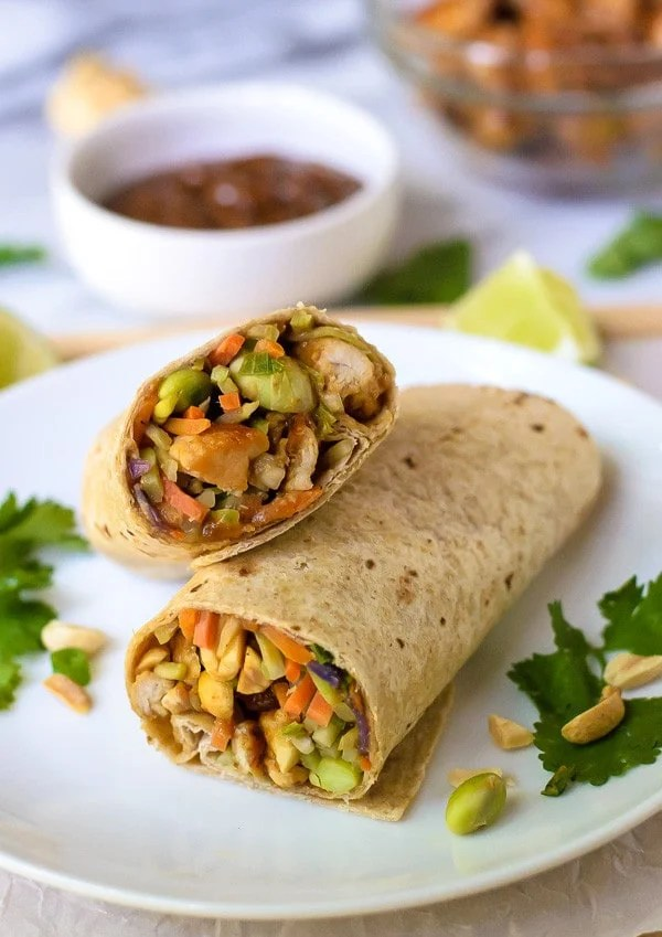 Asian Chicken Wraps with Thai Peanut Sauce. An easy and healthy chicken wrap recipe that's perfect for weeknight dinner or to pack for lunch