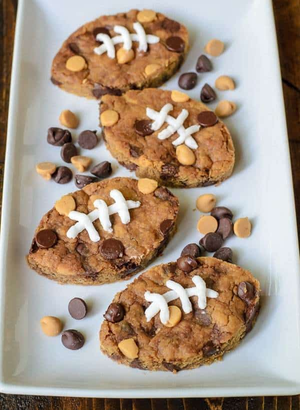Peanut Butter Football Blondies. Soft and chewy peanut butter blondies with chocolate chips and peanut butter chips, cut into the shape of a football. So cute for football parties, tailgates and the super bowl