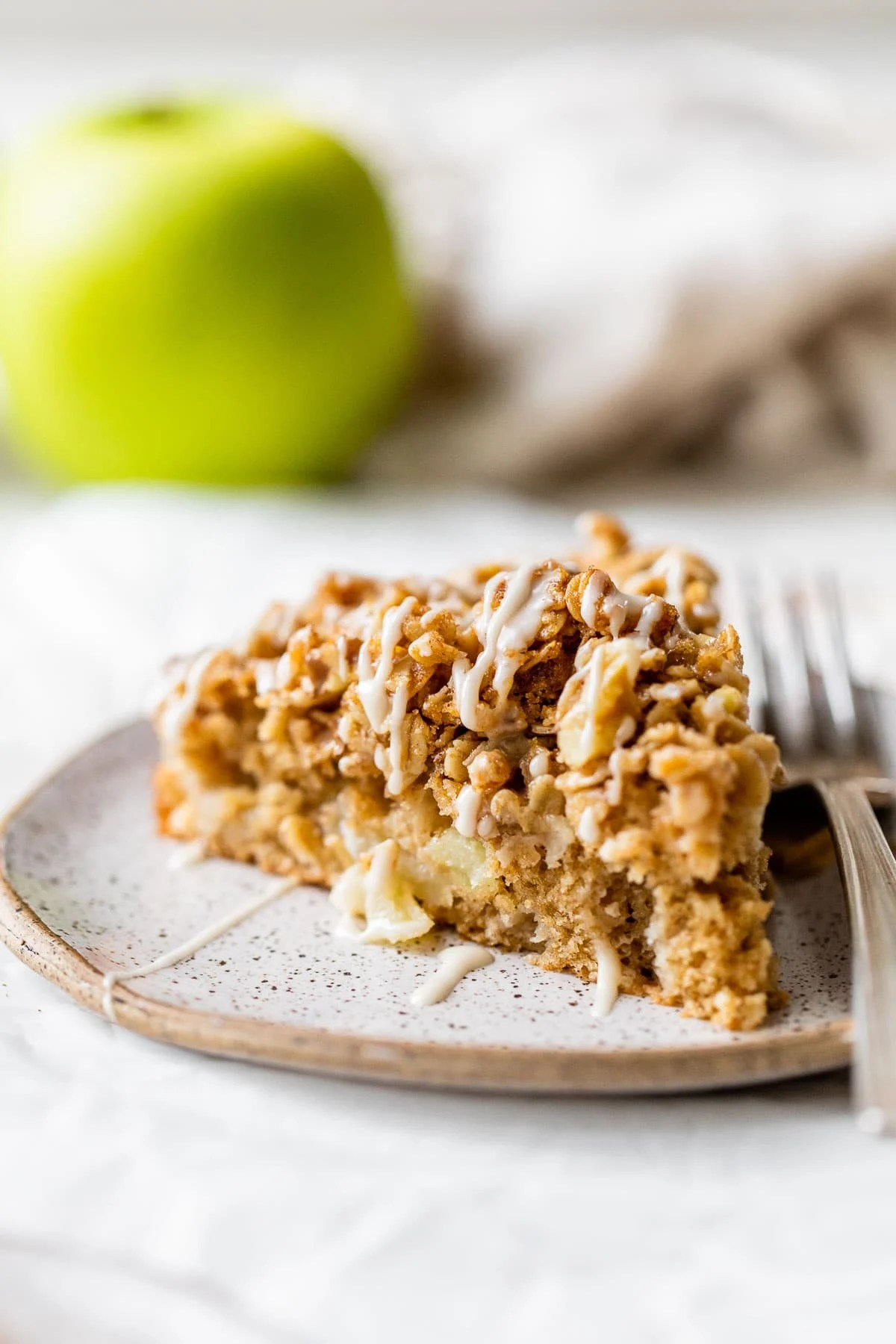 Best Ever Apple Coffee Cake with Extra Cinnamon Streusel Topping. SO moist and the walnut oat topping is addictive!
