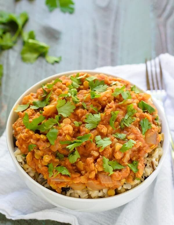 bowl of healthy red lentil curry with cauliflower