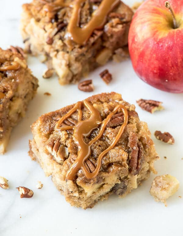This Gooey Caramel Apple Cake tastes like a gooey butter cake and caramel apple combined! They are mind-blowing delicious, buttery, and SO much easier to make than apple pie!