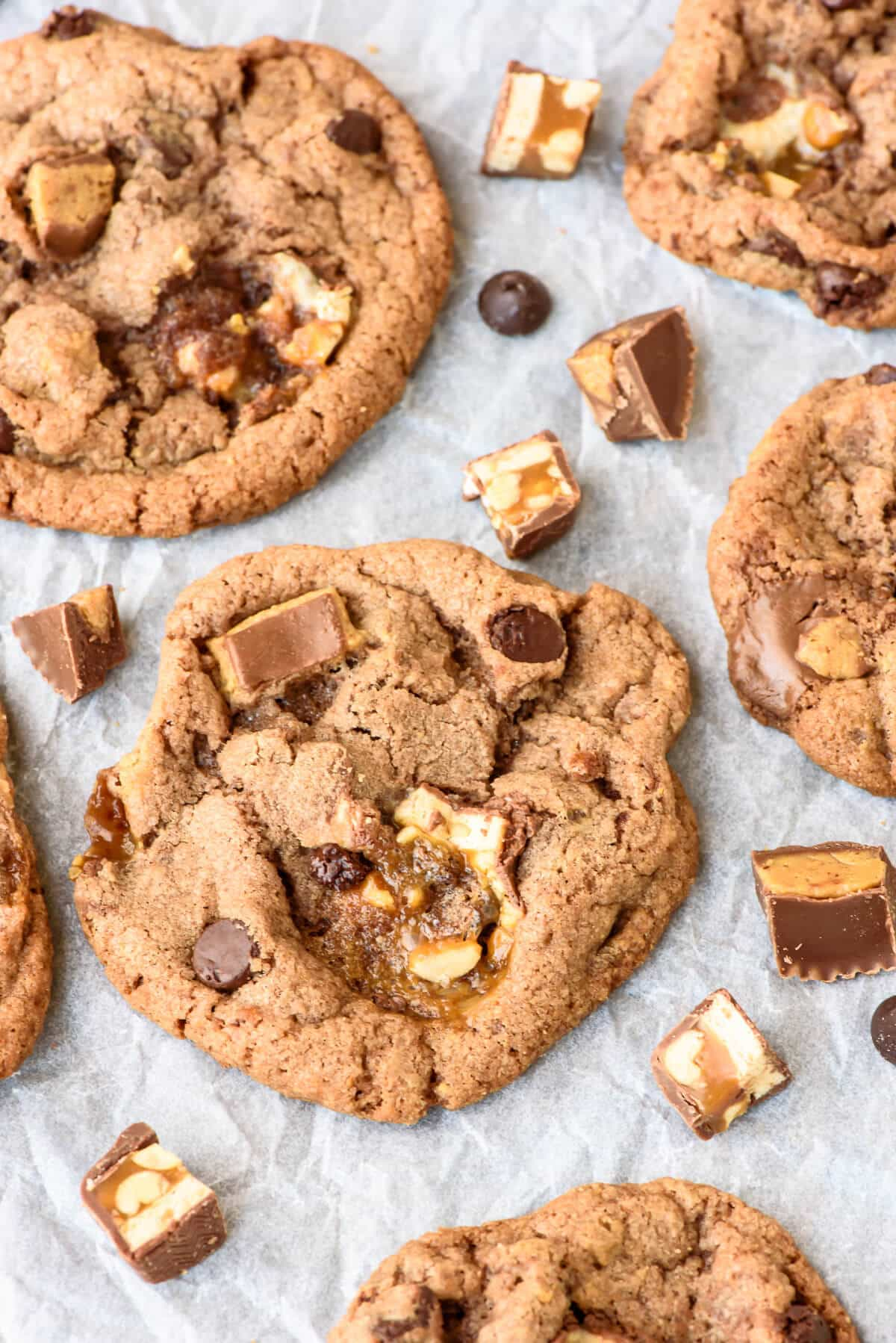 Soft and Chewy Peanut Butter Snickers Cookies. These are the BEST cookies. Caramel, chocolate, and peanut butter, baked into a soft chewy cookie. What's not to love?