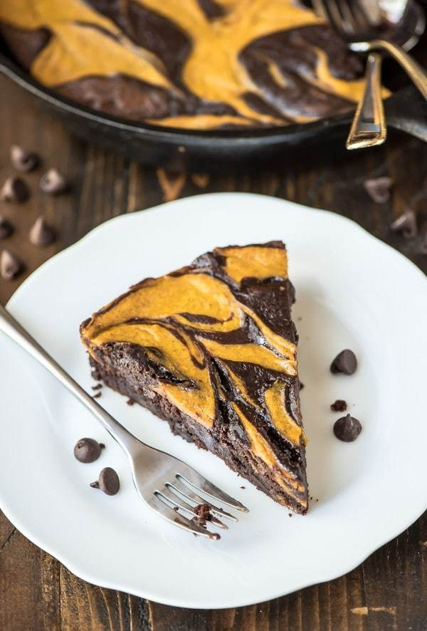Ultimate Pumpkin Brownies recipe. Pumpkin cheesecake swirled with rich, fudgy brownies. The ulimate pumpkin dessert!