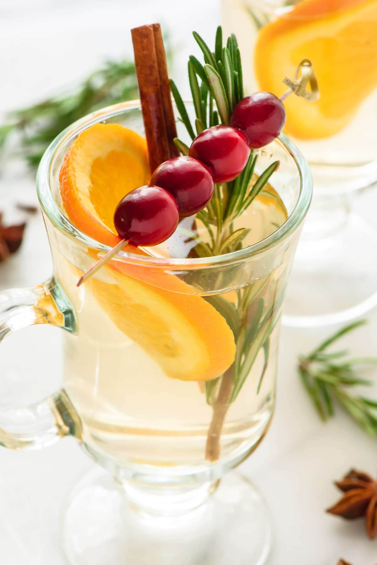 This Slow Cooker White Cranberry Mulled Wine is the perfect holiday party drink recipe! It's festive, easy and cheap to make it big batches!