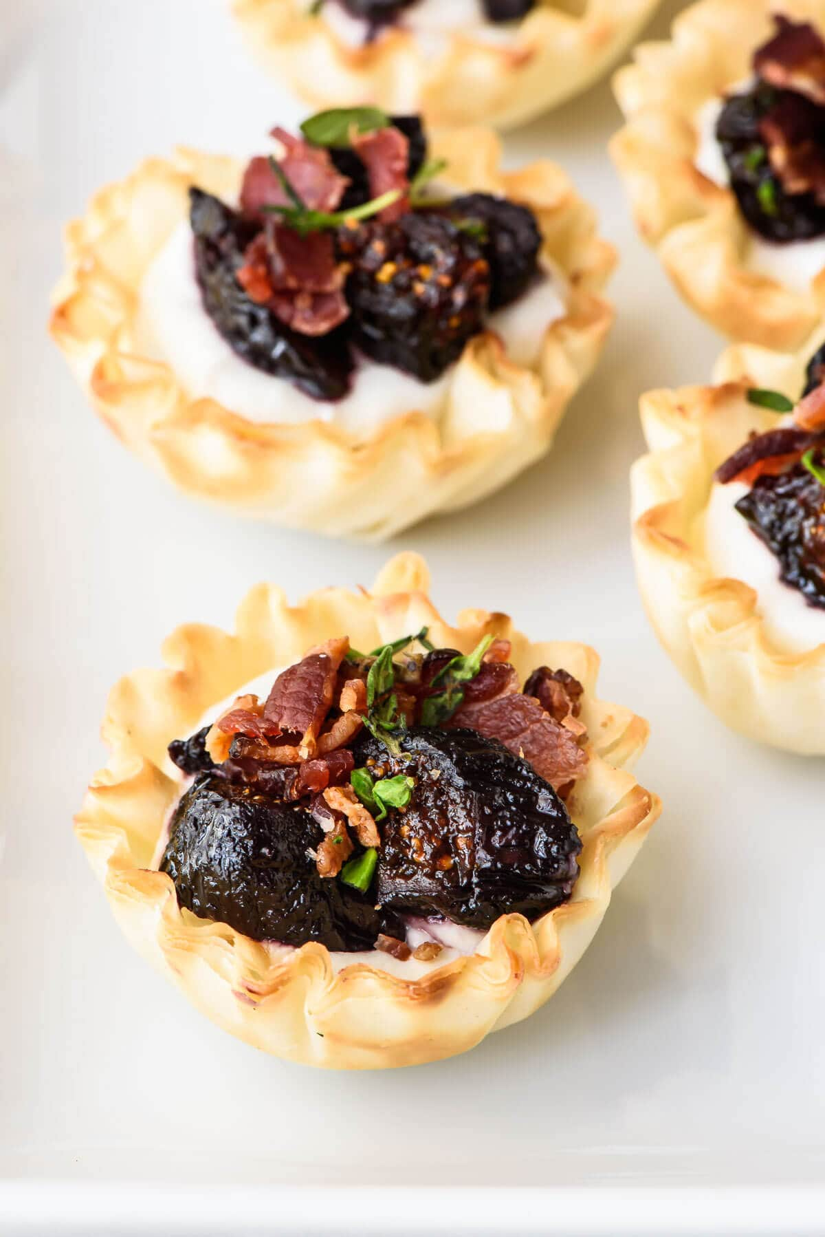 Mini Fig Goat Cheese Bacon Bites. Premade phyllo dough cups make for an easy but impressive appetizer!