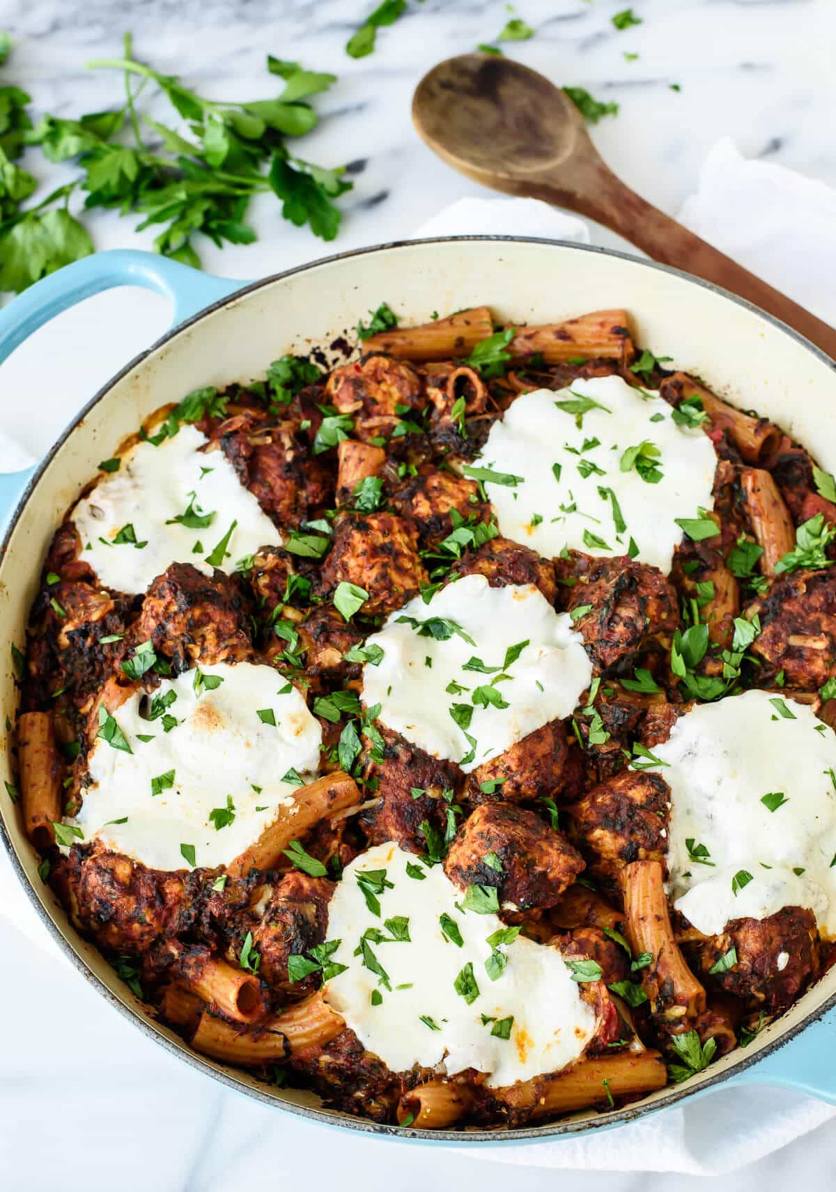 Mozzarella Meatball Casserole. Juicy turkey meatballs with whole wheat pasta and lots of gooey mozzarella cheese. Your entire family will love this recipe and it's healthy too!