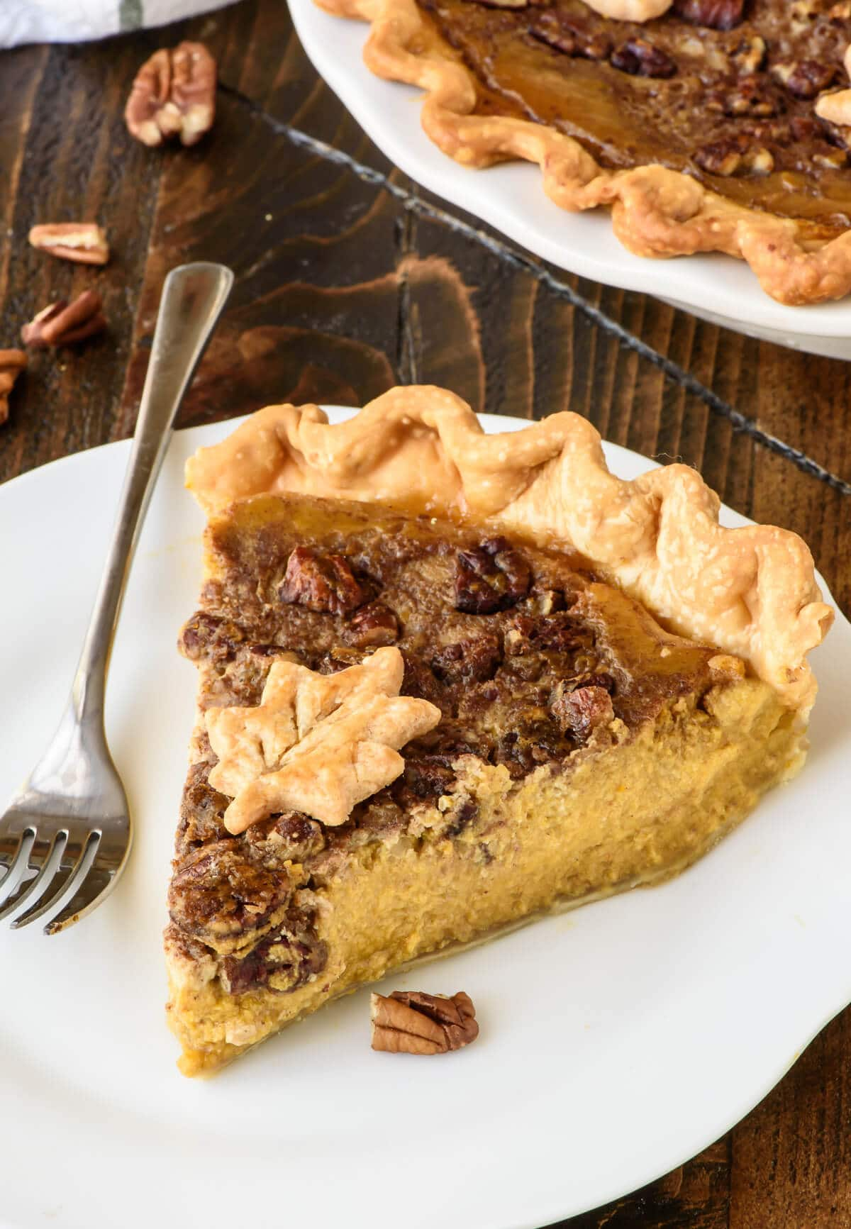 Perfect Pumpkin Pecan Pie. The best of pumpkin pie and pecan pie rolled into one, plus how to bake perfect pumpkin pie that won't crack or burn!