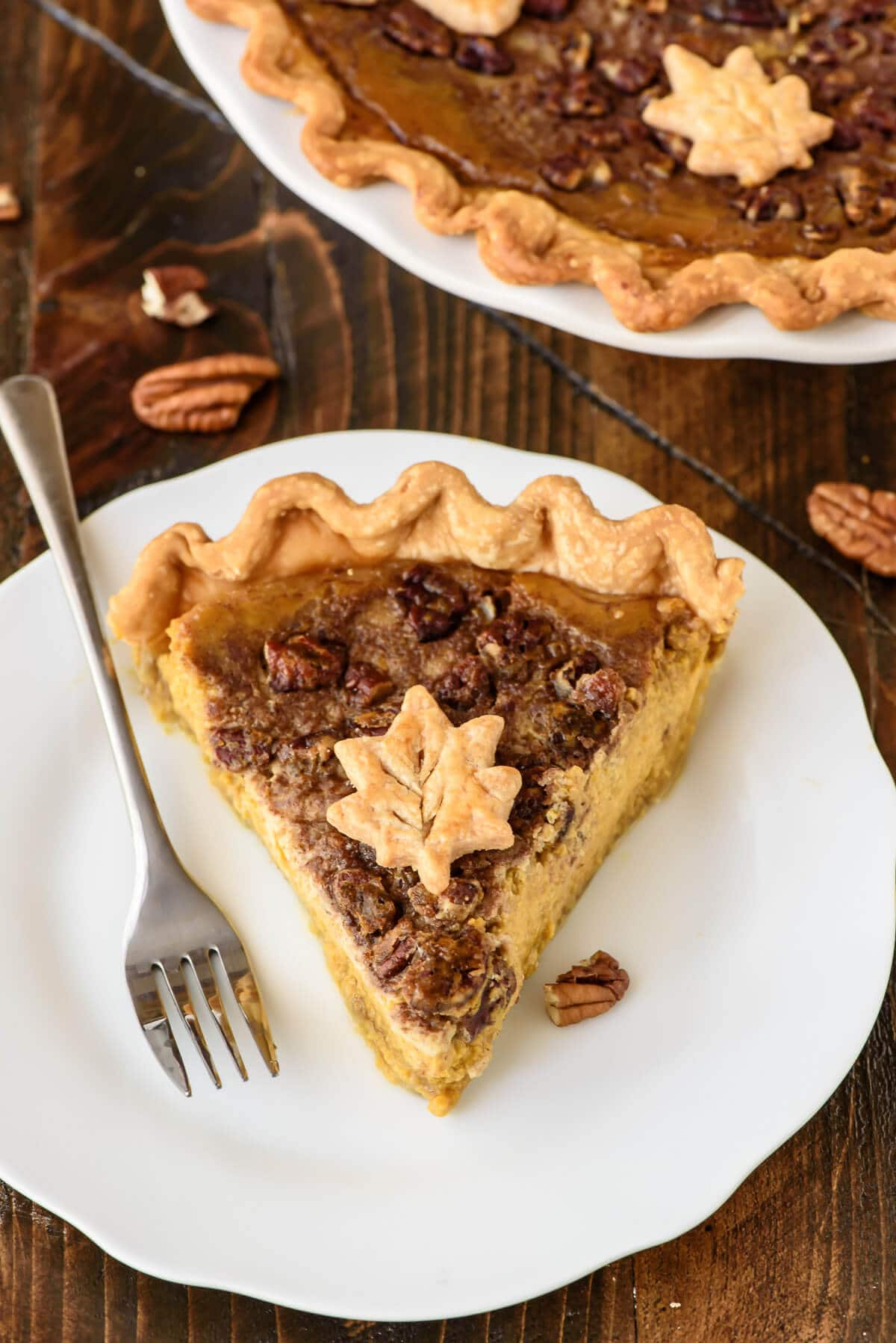 Perfect Pumpkin Pie with Butter Pecan Topping, plus how to bake perfect pumpkin pie that won't crack or burn. A perfect Thanksgiving dessert recipe!