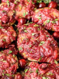 Sticky Cranberry Chicken Thighs. The whole meal cooks in one pan and is healthy AND delicious. Winner dinner!