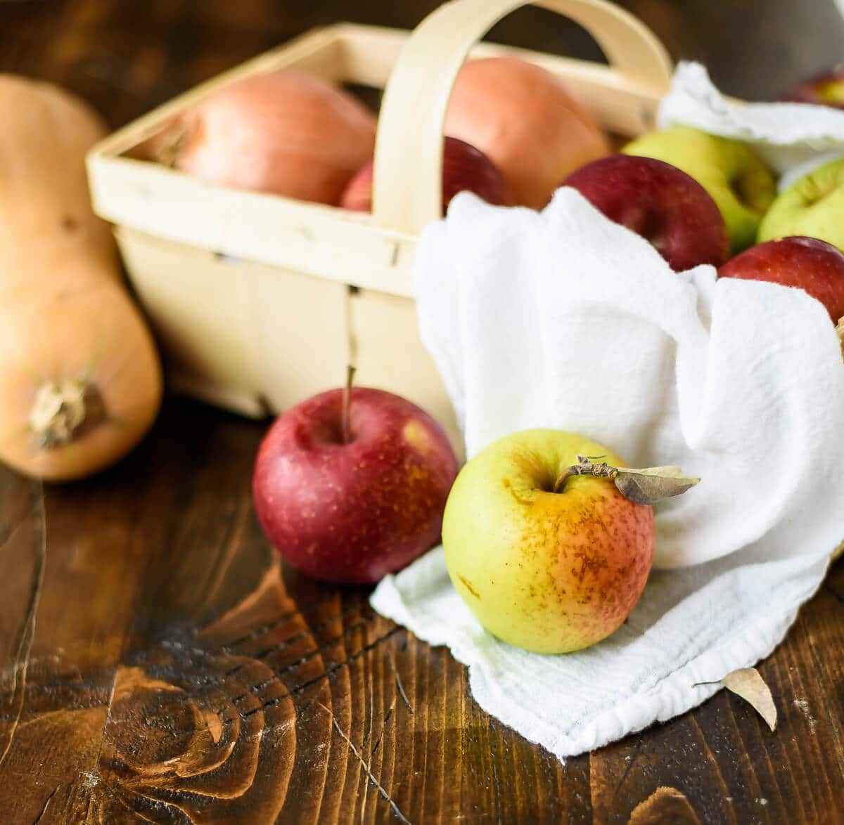 basket of fresh apples and butternut squash