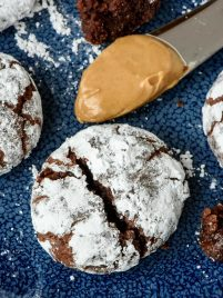 Ulimate Fudgy Chocolate Crinkle Cookies are made even better with PEANUT BUTTER. If you like chocolate crinkles, you will flip for these!