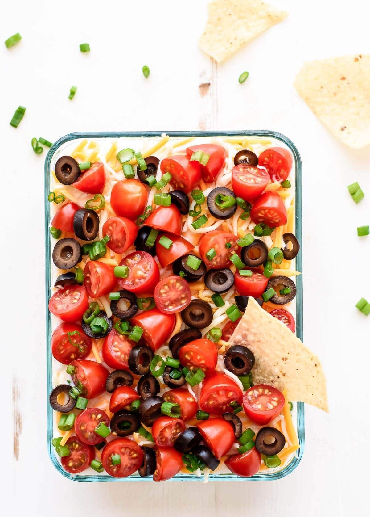 This 7 Layer Taco Dip recipe is made with fresh, simple ingredients and is a hit at any party!