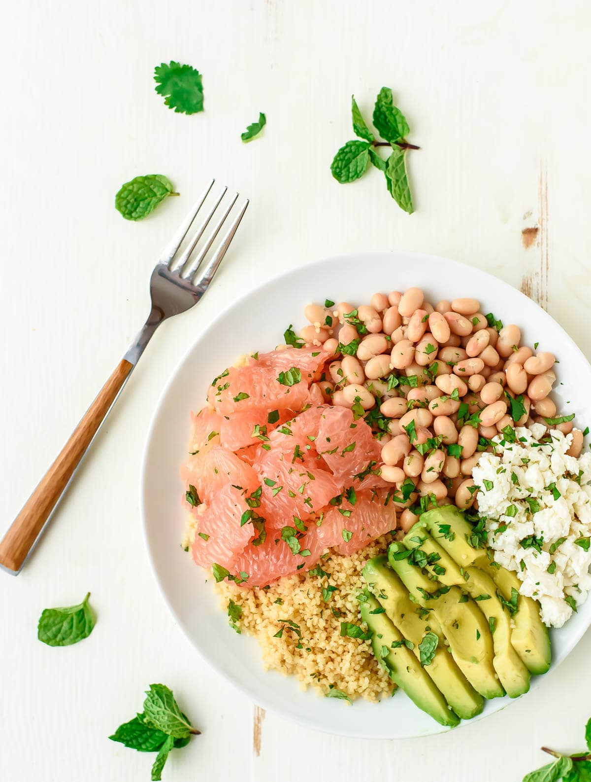 Avocado Grapefruit Salad with Couscous and White Beans. A healthy, satisfying and beautiful salad that's perfect for a light lunch or side.