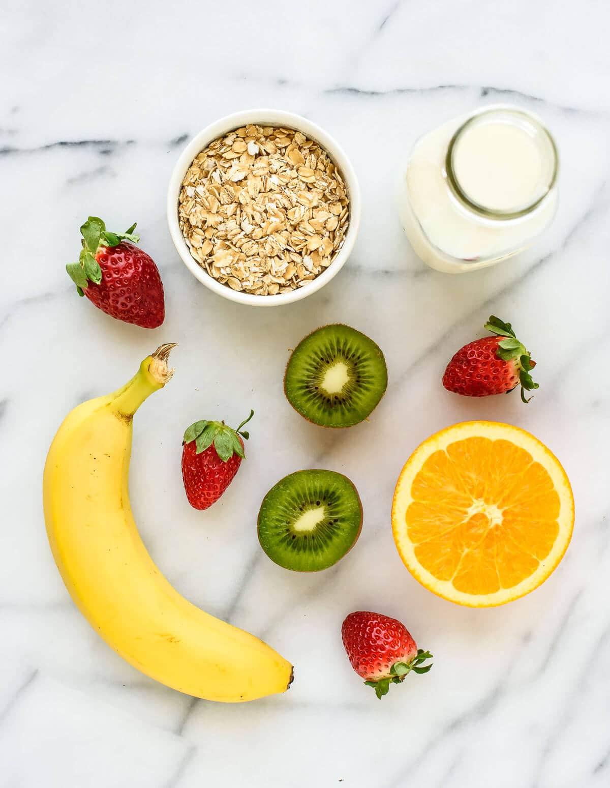 A healthy Strawberry Kiwi Smoothie with orange, banana, and oatmeal.