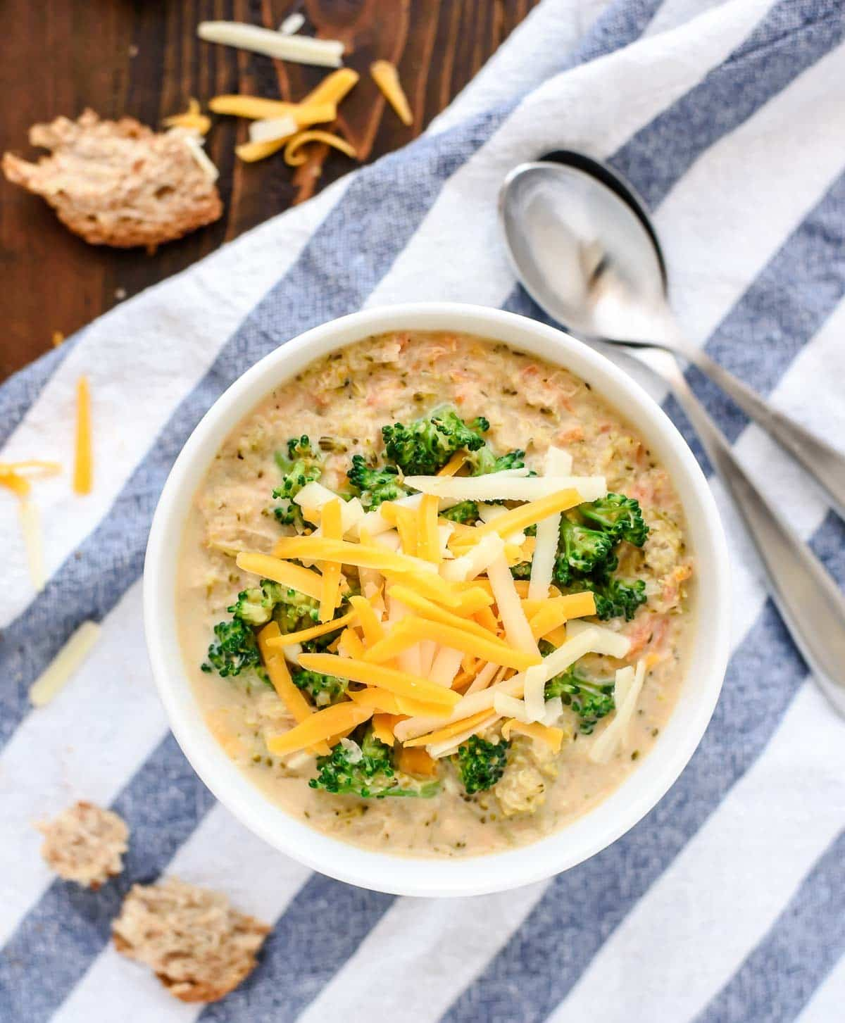 a white soup bowl filled with Slow Cooker Broccoli and Cheese Soup