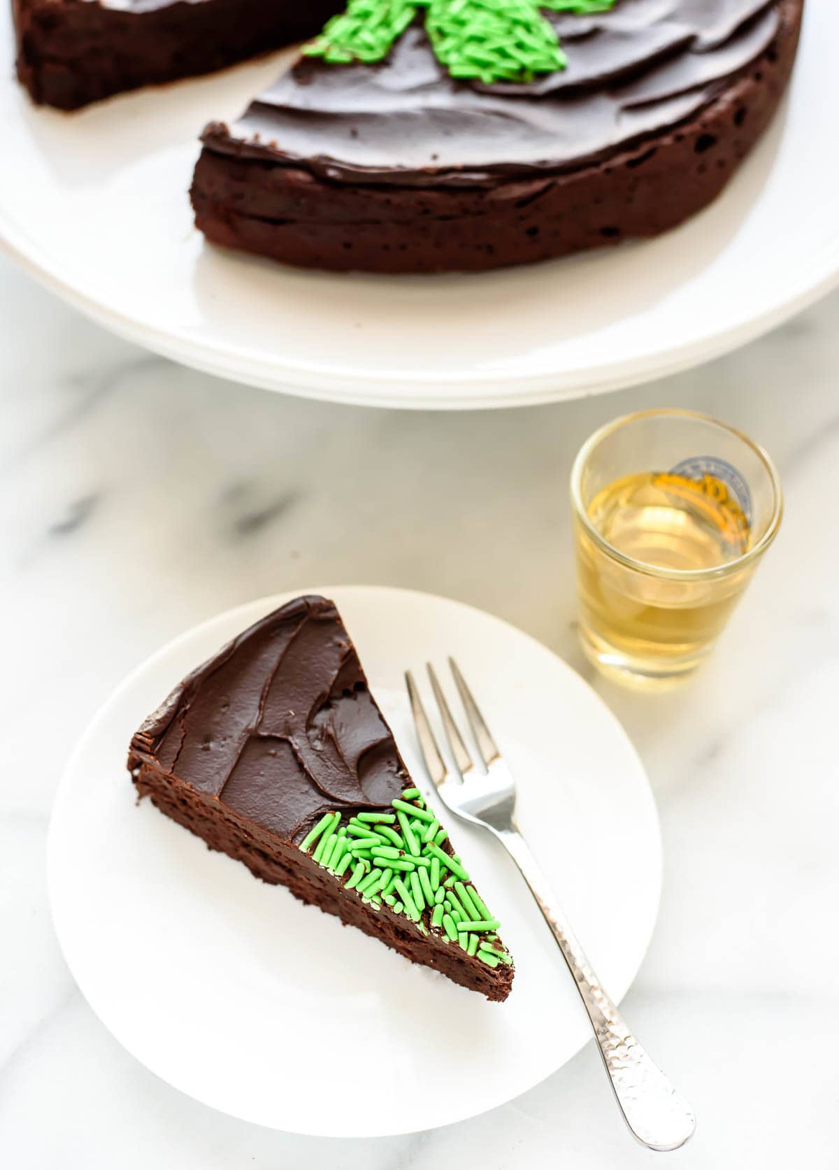 A rich, dense flourless chocolate cake made with WHISKEY! Topped with whiskey chocolate ganache, it's easy to make and a perfect St. Patrick's Day dessert. @wellplated