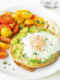 Egg in a Hole, made in a bagel with smashed avocado on top. Our family's favorite breakfast, and it's perfect for easy, healthy lunches and dinners too! @wellplated