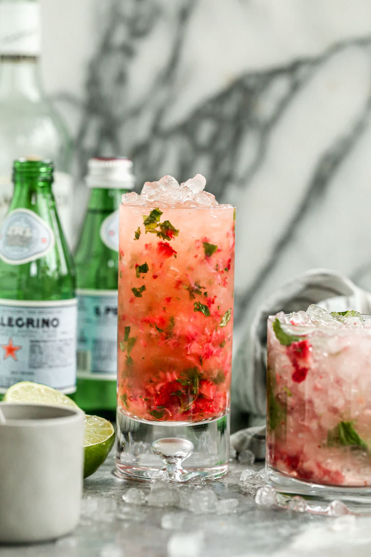 This easy Blueberry Strawberry Mojito is perfect for any cocktail party. The red, white, and blue make it so fun for Fourth of July or Memorial Day too! Refreshing, fun, and irresistibly tasty. @wellplated