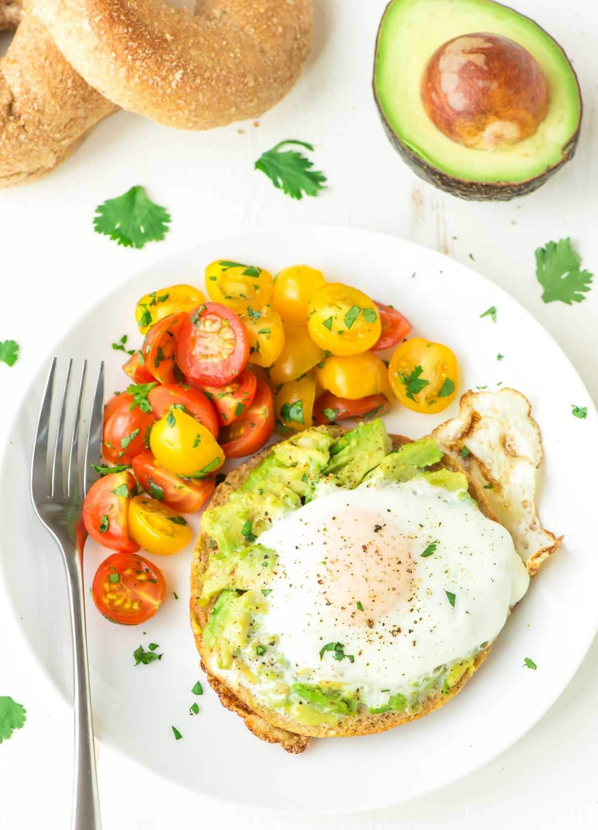 Move over avocado toast! This egg in a hole cooked inside a bagel with smashed avocado is easier and more filling. Our family loves this easy breakfast, and it's perfect for quick lunches and light dinners too! @wellplated