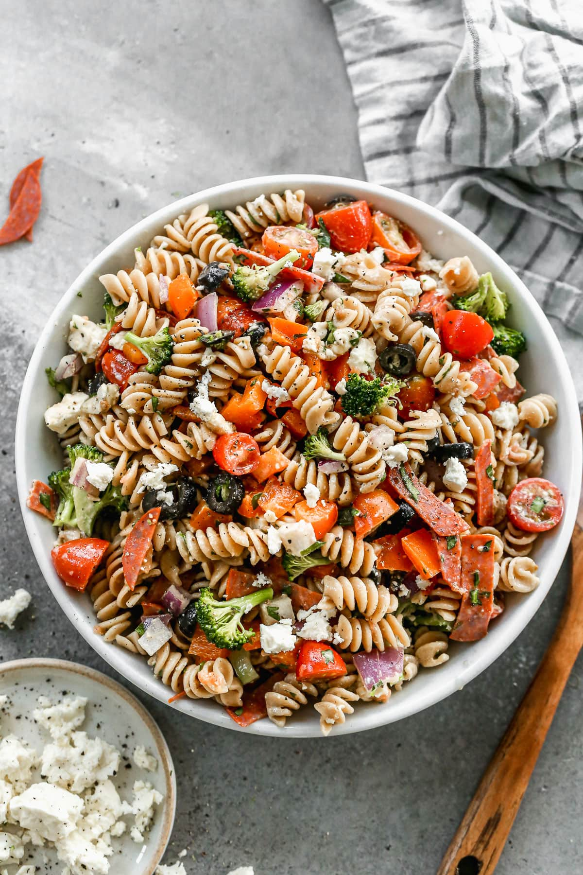 Pepperoni Pizza Pasta Salad — our favorite pasta salad recipe and PERFECT for a summertime lunch or dinner. Made with an easy homemade Italian dressing and loaded with meat, cheese, and fresh crunchy veggies @wellplated