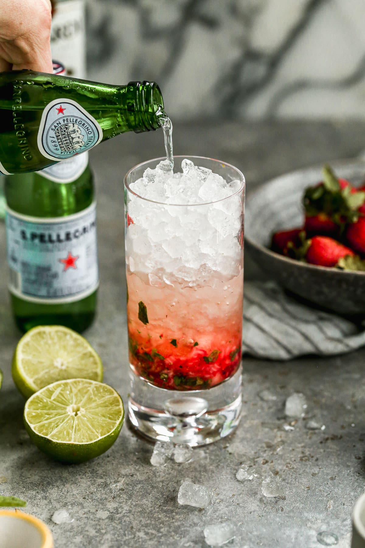 The perfect red, white, and blue Memorial Day or Fourth of July drink — Strawberry Mojito with Blueberries! Refreshing, fun, and great for any cocktail party. @wellplated