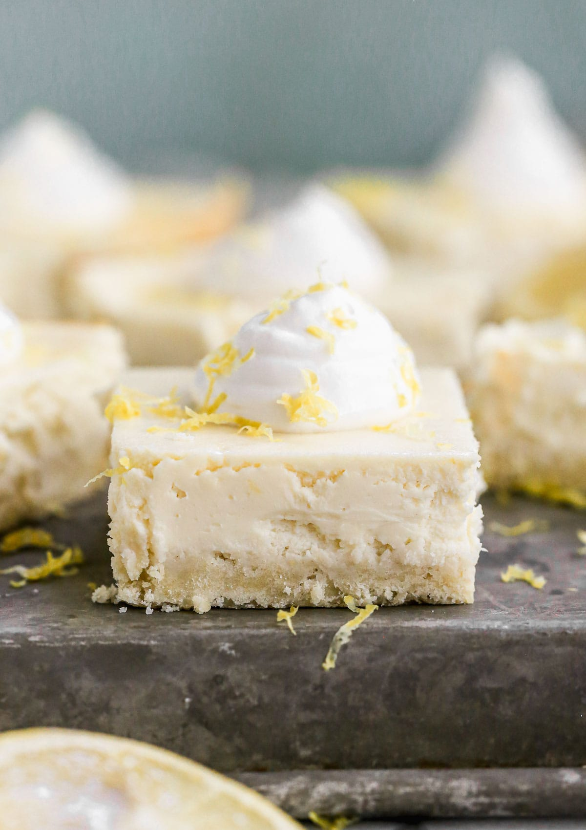 Strawberry Lemon Cream Cheese Bars — luscious lemon cheesecake on top of buttery shortbread crust with an inner layer of strawberry jam. To die for! @wellplated