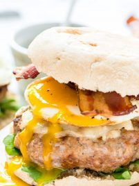 Sweet and smoky Maple Bacon Burger — This is BEST BURGER recipe I've ever made! Juicy turkey patties with cheese, bacon, a fried egg, and maple mustard drizzle. @wellplated