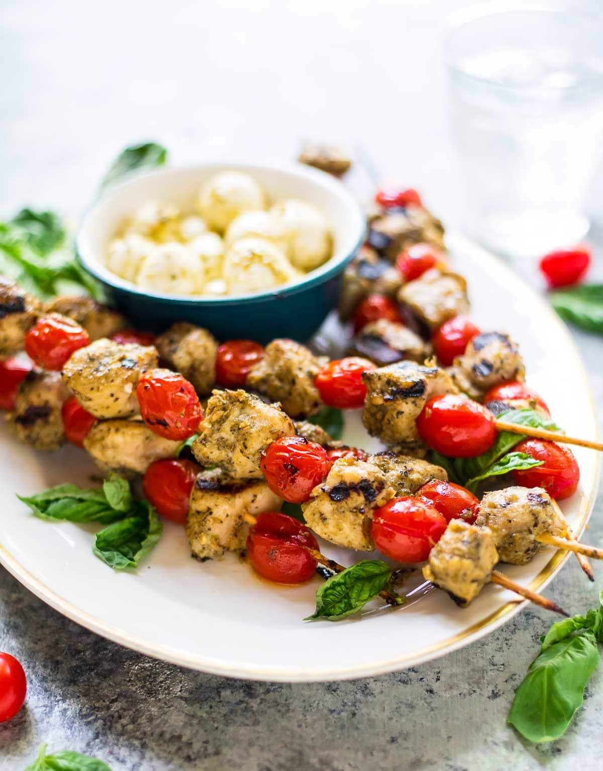 Grilled Chicken Pesto Skewers — No-fuss 3-ingredient kabobs! An easy, light, and healthy summer recipe that's perfect for busy weeknights and summer parties. Can be made a day ahead too! @wellplated