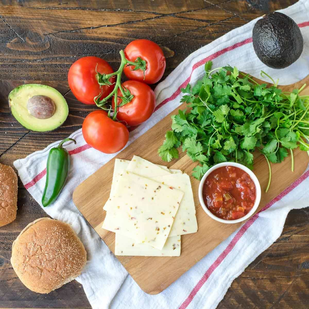 Green Chile Chicken Burgers with avocado and cheese— so MOIST and juicy! An easy, healthy recipe our whole family loves. @wellplated