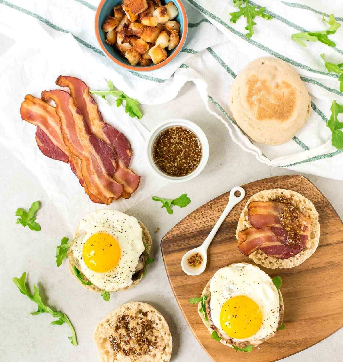 Maple Bacon Breakfast Burger — Juicy maple turkey burger patty with melty cheddar cheese, bacon, and a fried egg. The sweet and smoky flavors in this recipe are amazing! @wellplated